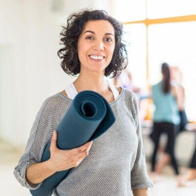 lady leaving yoga with facial injectables image