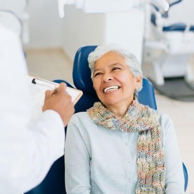 woman getting white dental filling image