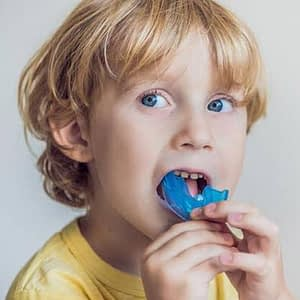 Young-boy-wearing-a-custom-made-sports-mouthhguard image