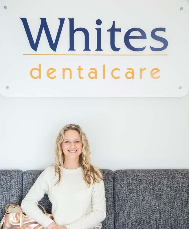 Woman sitting at dental clinic reception at Whites Dental Care dentist Neutral Bay image