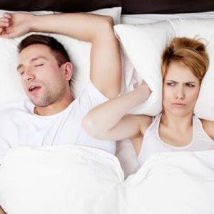 man snoring with sleep apnea image