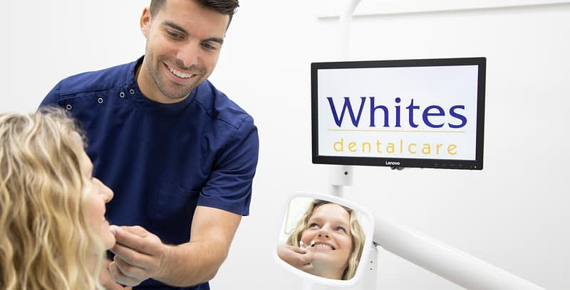 Patient getting dental treatment at whites dental care image