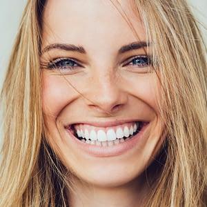 Woman-smiling-with-porcelain-veneers-image