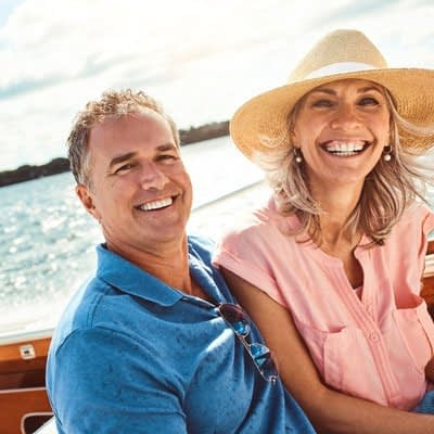 couple with dental implants image
